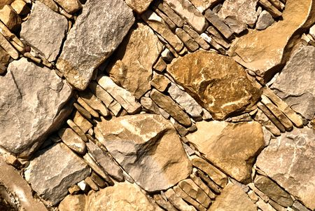 Closeup of Detail of a Brown Stone Wall  photo