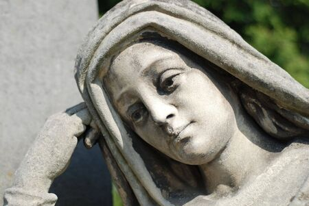 Face of madonna, old stone statue