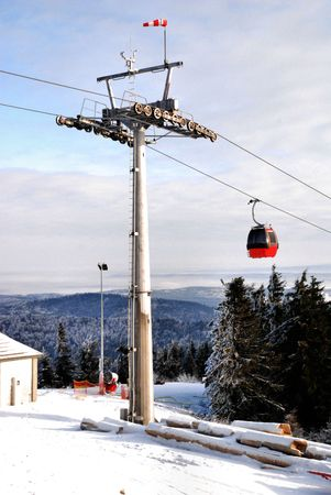 Winter landscape with a red cable car photo
