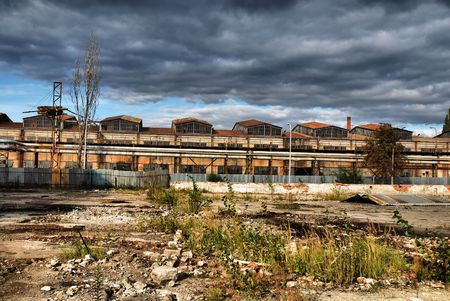 Old shut down factory is overshadowed by dark stormy clouds Stock Photo - 6652539