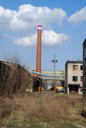 antique factory: Building of antique factory with chimney Stock Photo
