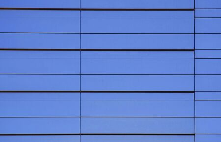 Wall of modern office building and sky reflection photo