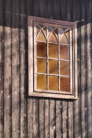 old window in a wooden wall