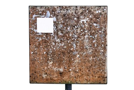 An old rundown antique weathered blank wooden sign post  photo