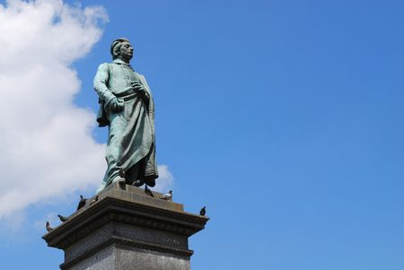 Statue of the Polish poet - Adam Mickiewicz in Cracow. Poland photo