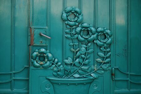 old wooden door with aged flower texture  photo