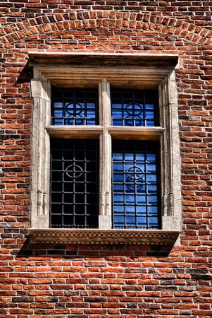 transom:  Window of a medieval building, very old brick wall