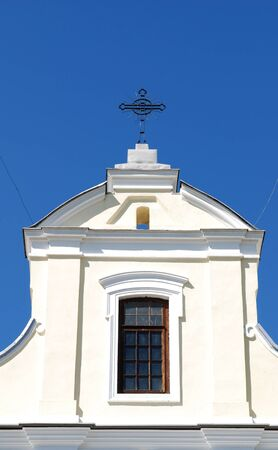workship: church tower with sun and blue sky