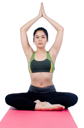 Beautiful young asian woman in yoga pose  Stock Photo