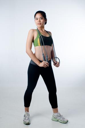 yoga pants: Sporty beautiful woman with skip rope Stock Photo