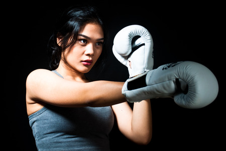 Asian Female Boxer on Black Background