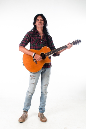 guy playing guitar: Long hair guy playing guitar acoustic