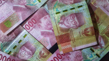 Extreme close up of many indonesia money of one hundred thousand rupiah