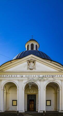 the church of Santa Maria Assunta, in the monumental Piazza di Corte, by Gian Lorenzo Bernini and the Chigi family. The dome and the bell tower with the cross. Ariccia, Castelli Romani, Lazio, Italy.