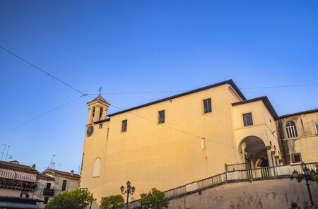 The Convent of S. Maria delle Grazie, in Santa Maria square. The bell tower with the clock. The blue sky at sunset. Zagarolo, Province of Rome, Lazio, Italy