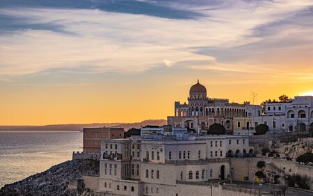 a view of Santa Cesarea Terme at sunset, with its splendid Arab and Moorish palaces, Puglia, Salento, Italy. Hydrothermal station in the province of Lecce, between Otranto and Santa Maria di Leuca.