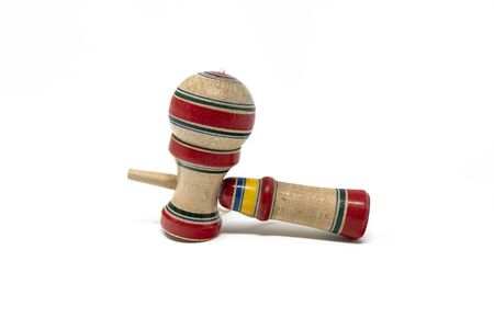 The original Kendama. An ancient, traditional, wooden Japanese skill toy for children. Has three cups and a spike which fits into the hole in the ball. Isolated on white background.