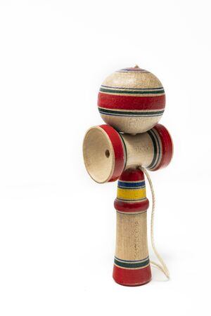 The original Kendama. An ancient, traditional, wooden Japanese skill toy for children. Has three cups and a spike which fits into the hole in the ball. Isolated on white background. Reklamní fotografie