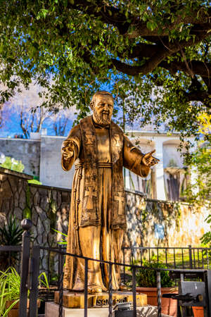 February 17, 2019 - Frascati, Rome, Lazio, Italy - Bronze statue of Saint (Father) Pio of Pietrelcina, who welcomes the devoted with open arms, the stigmata on his hands. Venerated in Catholic Church