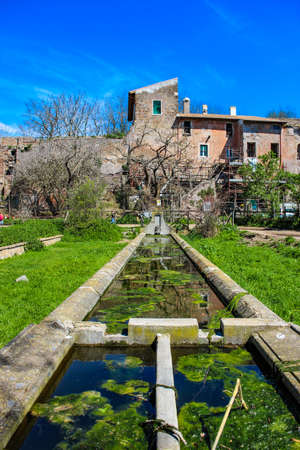 a farm with a watering hole for animals, inside the Caffarella park, Rome, Italy, Lazio.