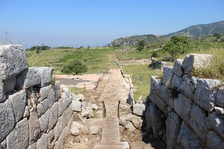 Archaeological site of the ancient city of Norba Latina, in the province of Latina, Lazio, Italy. The remains of stone walls and cobblestone streets.