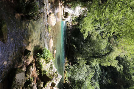 The waterfall of San Benedetto in Subiaco, Rome, Lazio, Italy. Rich vegetation in the woods. Cool place, refreshment from summer heat. Trekking, mountain excursion. Peace, silence, nature.