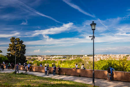 May 9, 2021 - Rome, Lazio, Italy - Many tourists strolling admire the beautiful panorama of the city, seen from the top of the Janiculan Hill (Janiculum).