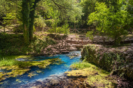 The sulfur springs of Raiano, immersed in a forest and uncontaminated nature, in Abruzzo, Italy. Peace, relaxation, silence, health and well-being. Remains of ancient walls covered with vegetation.