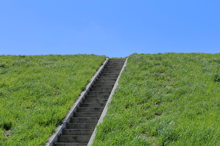 Isolated stairs, green grass, blue sky