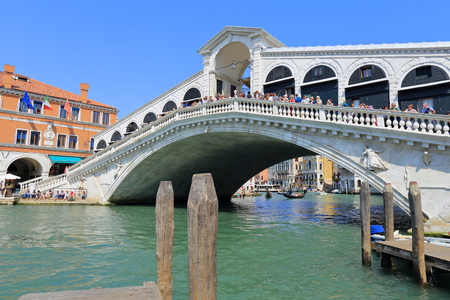 Venice - April 10, 2017: The view on Rialto Bridge on the Grand Canal, on April 10, 2017 in Venice, Italy