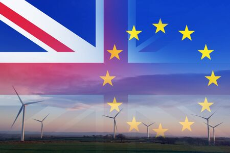 Brexit concept. A wind farm at sunrise with the flags of the Union Jack and the E.U over layered on top.