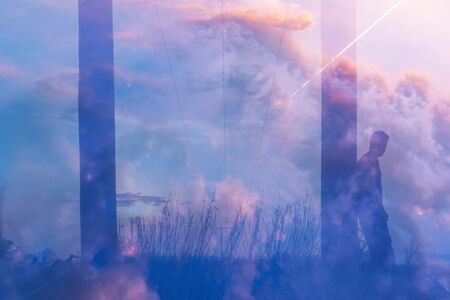 A transparent figure of a man looking up at a plane going across the sky. In a field next to telegraph poles With an abstract, experimental dream like edit.