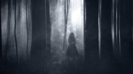 A woman in a dress standing in a magical forest out of focus. With a grunge, blurred textured edit.