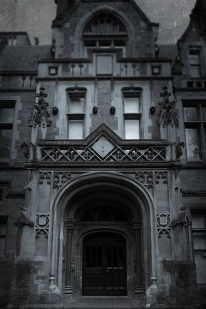 An imposing Victorian building and door. With a grunge, vintage edit