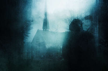 A spooky hooded figure, back to camera. Looking at a church with tower. In a graveyard on a winters day. With a grunge, abstract edit.
