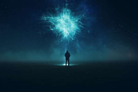 A spooky alien encounter. Of a man silhouetted against the night sky, holding a torch, looking up at a floating alien cloud. With an abstract, artistic, edit Standard-Bild