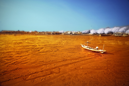 wrecked: Wrecked boat at receding shore