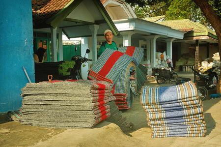 kriya: Pile of traditional colorful carpet, Taken at Mendongan Handicraft, Malang, east Java, Indonesia Stock Photo