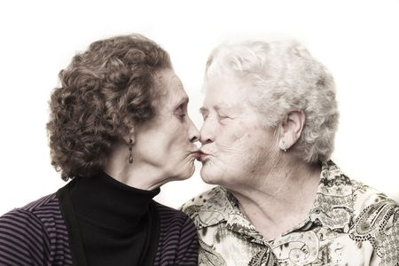 Old ladies share a kiss photo