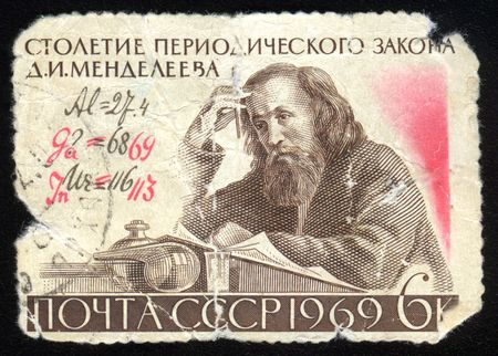 mendeleev: Old jagged dirty vintage antique postage stamp from Russia with Mendeleev