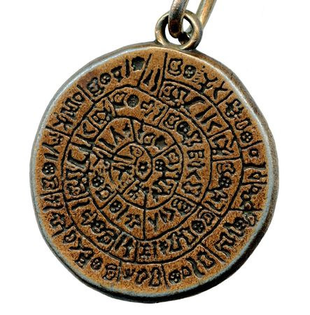 Vintage mystery amulet from old metal isolated on white background photo