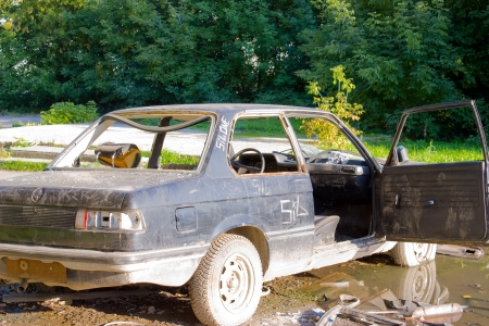 A old abandoned car to background Stock Photo - 4035906