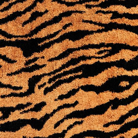 Close-up tiger  fabric textile texture to background photo