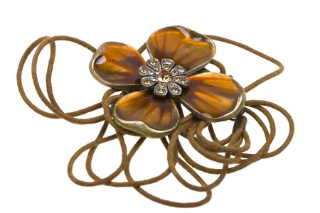 coulomb: Vintage brown pendant, coulomb flower isolated on white background