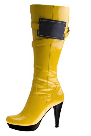 clasp feet: Stylish high heel fashion yellow boot with empy label  isolated on white Stock Photo
