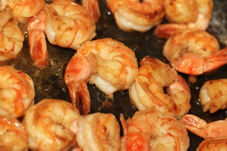 Frying pan with lots of shrimps photo