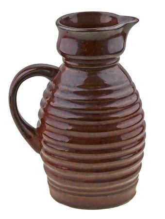 Vintage olg ceramic jug isolated on white background photo