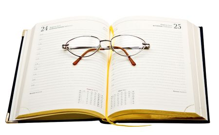 dayplanner: Daily planner with glasses isolated on white background