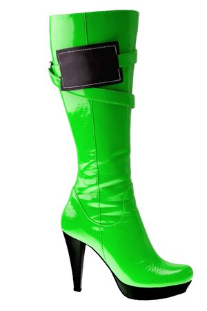 clasp feet: Stylish high heel fashion green boot with empy label isolated on white background