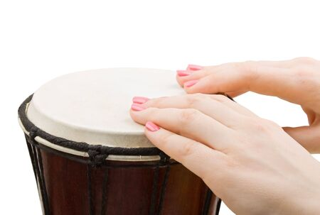 Close-up of girl drummers hands playing percussion isolated on white background